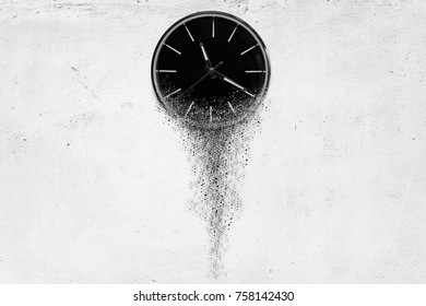 Classic clock on white concrete background disintegrate in a small parts and flowing away. Time flying concept