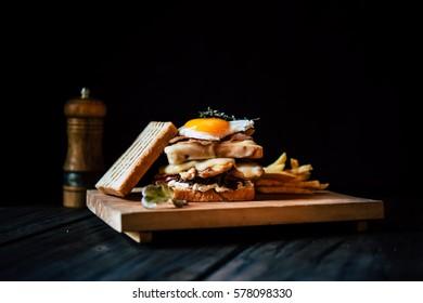 Classic club sandwich with fried egg