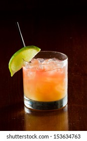 classic cocktail, madras, vodka cranberry and orange juice served in a glass on a dark bar