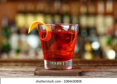 Classic cocktail Negroni with gin, campari and martini rosso. Traditional recipe. Place for writing text