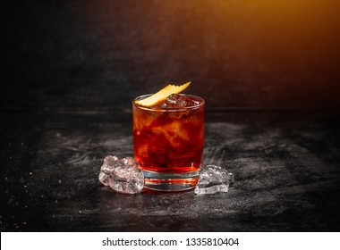 Classic cocktail Negroni with gin, campari, red vermouth and soda water. Traditional recipe. Place for writing text