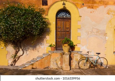 Classic, common Sicilian doorway with bicycle