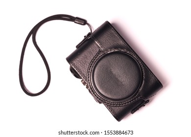 Classic compact camera in case isolated on white background.