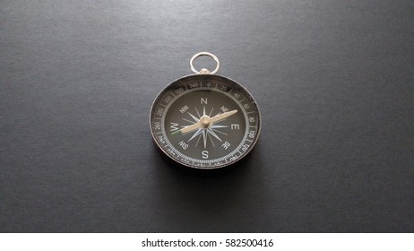 Classic compass isolated on black background. shallow DOF, selective focus