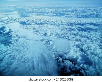 Classic cotton ball clouds (Altocumulus) and fog in upper layers of the atmosphere.