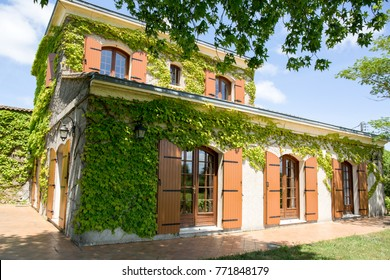 classic country house in France with green binding on the facade