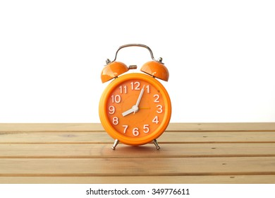 Classic design orange alarm clock isolated on white
