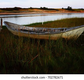 A classic Dory boat moored at low tide on the edge of the Ogunquit river in Maine.
