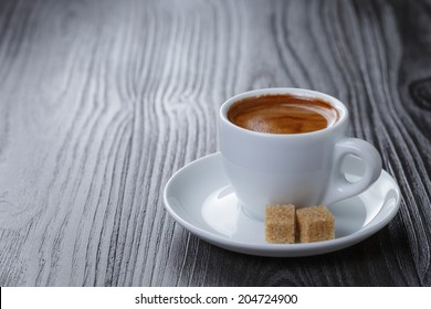 classic double espresso on wood table, with sugar cubes