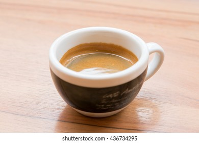 classic double espresso on wood table, close up