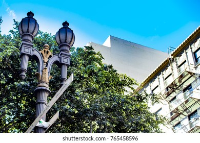 Classic Double Light Street Lamp Lining the Side of the Street with a Tree and High-rise Buildings behind It in the Old Bank District of Downtown Los Angeles