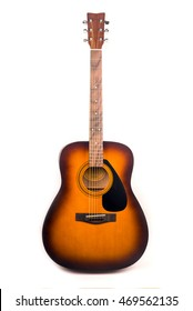 Classic dreadnought acoustic guitar with rosewood fretboard and tobacco brown sunburst color isolated over white background.