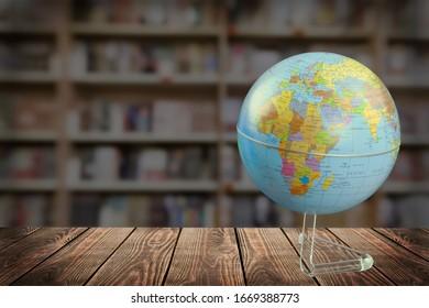 Classic earth globe on wooden desk