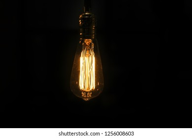 Classic edison lamp on a dark background. Cafe interior element. Mock-up
