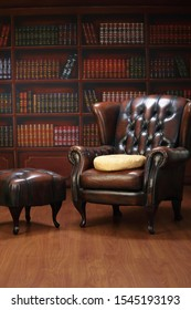 Classic Elegant Chesterfield leather sofa seat in the library ambient light room background ; retro furniture