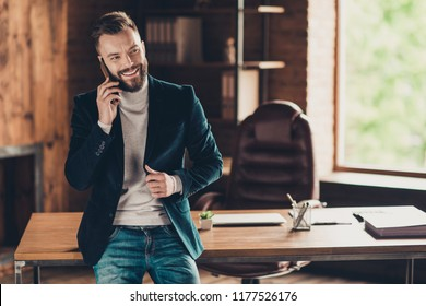 Classic elegant stylish smart cheerful content confident luxury bearded business shark, ceo, leader in black jacket, blazer and jeans, talking on phone at workplace, workstation