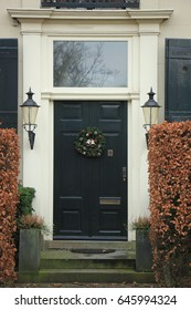 Classic entrance with decorated christmas wreath
