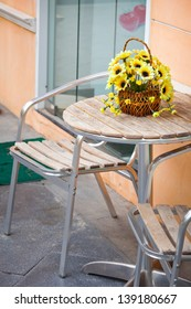 Classic exterior with chair and yellow flower