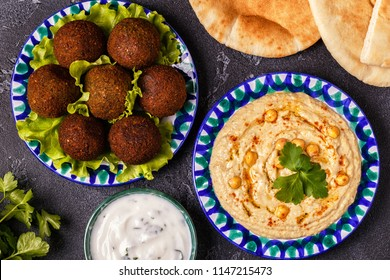 Classic falafel and hummus on the plates. Top view.