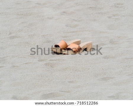 5f7699a10 ... Stock Photo (Edit Now) 718512286 - Shutterstock. classic female  handmade clogs on the beach