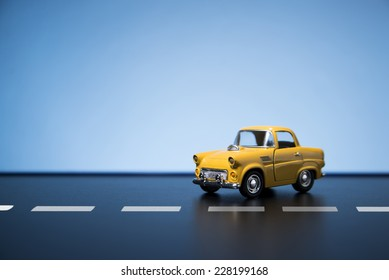 Classic fifties scale model toy car from front view.