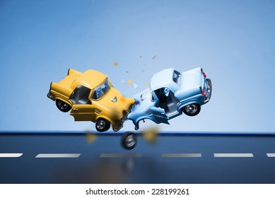 Classic fifties scale model toy cars accident on the road.