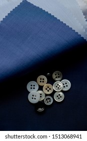 Classic, four hole, rimmed mother of pearl buttons for bespoke tailoring