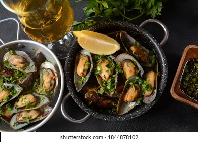 Classic French meal Moules marinière  Marinara mussels with garlic, sauce, lemon and parsley.