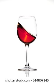 Classic Glass of Red Wine isolated on a white background. Splashing red wine in a glass. A splash of red wine in a glass. Grapes. Alcohol.