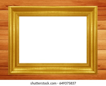 Classic gold frame on wooden wall background.