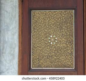 Classic gold metal pattern, Islamic Arabian Persia pattern. golden window closeup. wood
