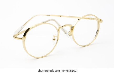 classic gold round glasses on white background