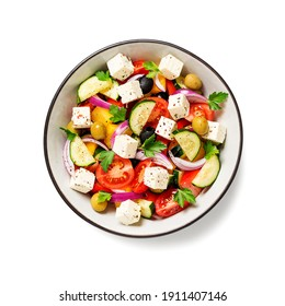 Classic Greek salad with fresh vegetables, feta cheese and  olives. Healthy food. isolated on white background. top view