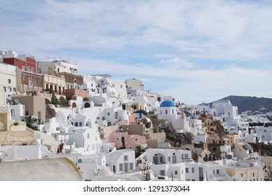 Classic Greek white and blue buildings on the slopes of the volcano caldera in Oia, Santorini, Greece