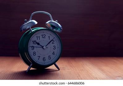 classic green alarm clock night slip time