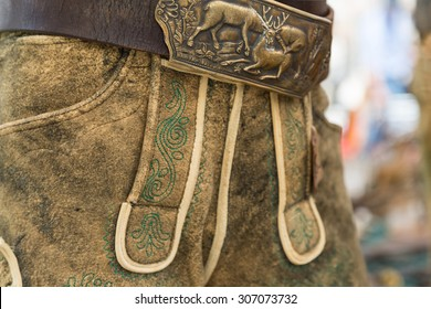 Classic green manual embroidery on traditional deerskin leather trousers from Salzkammergut, Austria
