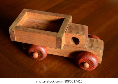 A classic handcrafted dump truck toy made from wood only.