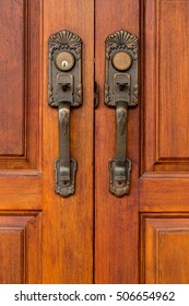 Classic handle and bolt on wooden door,closeup