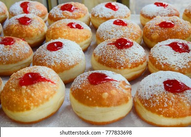 classic Hanukkah sufganiyot filled with strawberry jelly