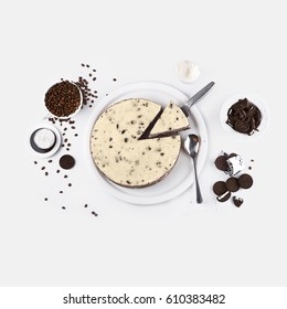 classic homemade oreo cheesecake with chocolate, coffee and cookies top view isolated