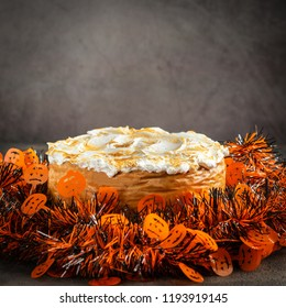 Classic Homemade Pumpkin Cheesecake with Marshmallow Meringue Topping decorated with Halloween toppers. Dessert for Halloween and Thanksgiving. Space for Text. Square.