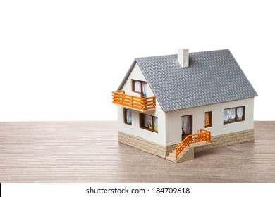 classic house model on wooden background
