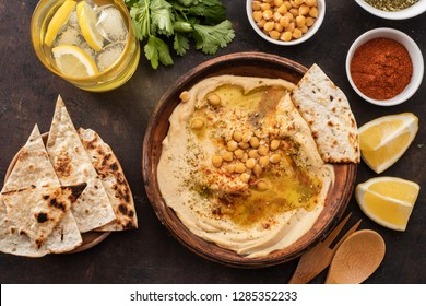 Classic Hummus with chickpeas, paprika, olive oil and oriental spices. Mediterranean popular snack of chickpeas and tahini pasta. Vew from above. Flat lay.