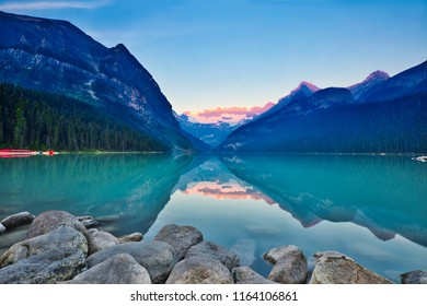 Classic iconic scene of Lake Louise during sunrise.  The picture is a bit hazy due to the BC forest fire.  This does not reduce the majestic view of the Victoria Glacier.