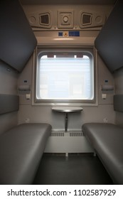 classic interior of sleeping car of train. interior of compartment car. Passenger train car. Sleeping car of passenger train