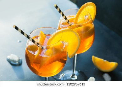 Classic italian aperol spritz cocktail in glass on dark. Close up.