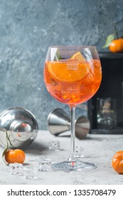 Classic Italian Aperol spritz cocktail in glass on gray background