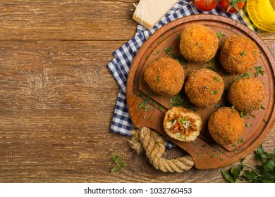 Classic, Italian arancini. Rice balls with minced meat. Top view.