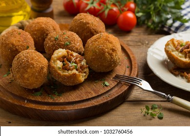 Classic, Italian arancini. Rice balls with minced meat. Front view.