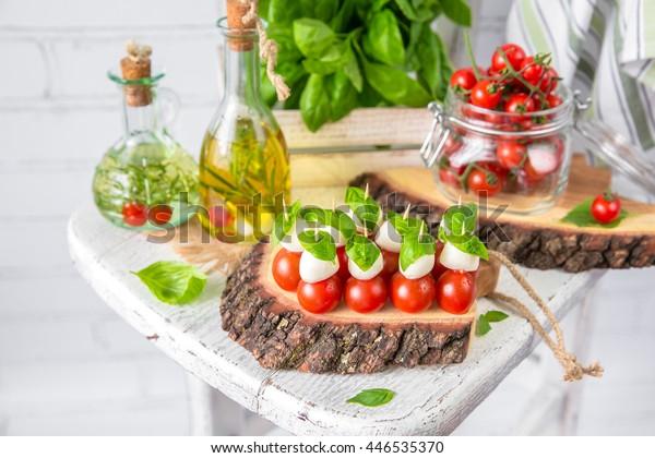 Classic Italian Caprese Canapes Salad With Tomatoes, Mozzarella di Buffala And Fresh Basil